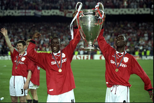 Dwight Yorke and Andy Cole celebrate